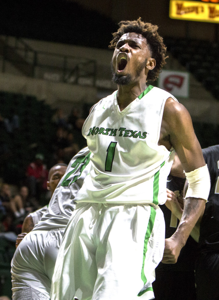 North Texas sophomore forward Jeremy Combs celebrates a dunk against Southern Illinois University. Colin Mitchell | Senior Staff Photographer