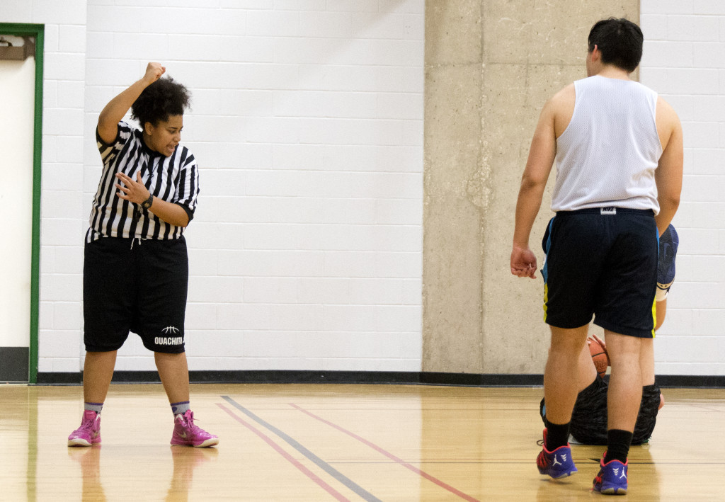 Math junior Taylor Vaughn blows her whistle on a foul during an intramural basketball game. Colin Mitchell | Senior Staff Photographer