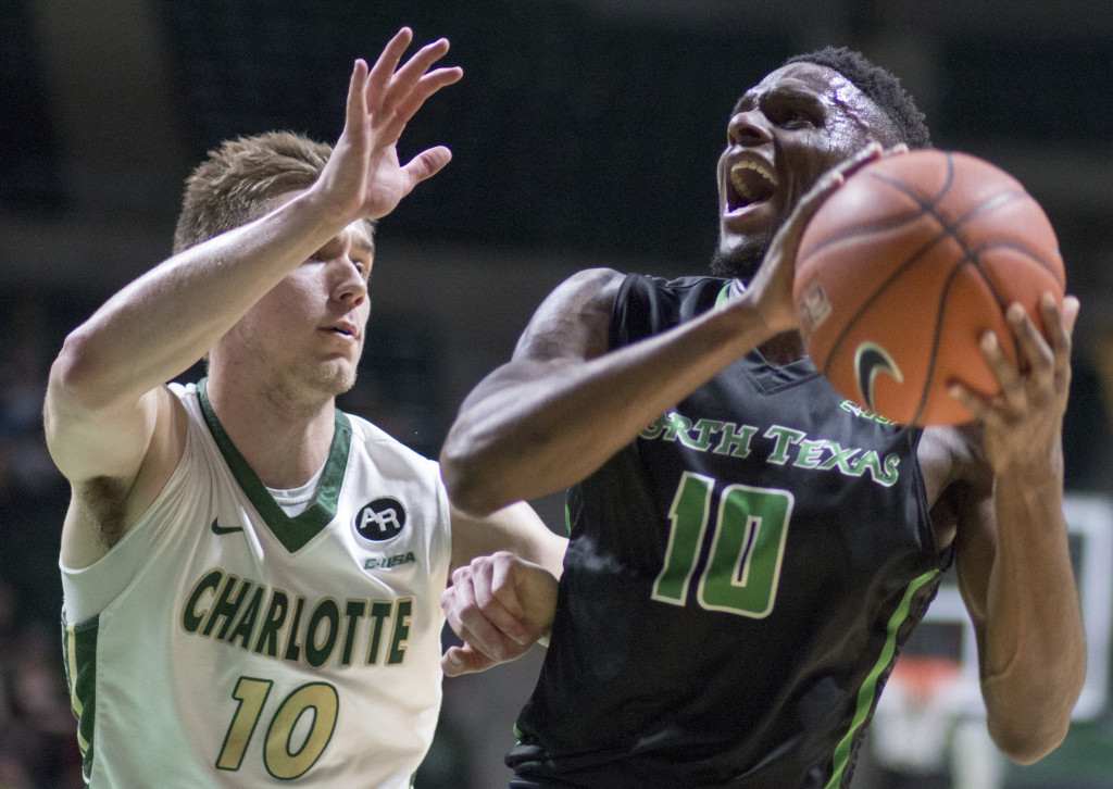 North Texas junior guard Deckie Johnson (10) drives the basket against the Charlotte 49ers. Colin Mitchell | Senior Staff Photographer