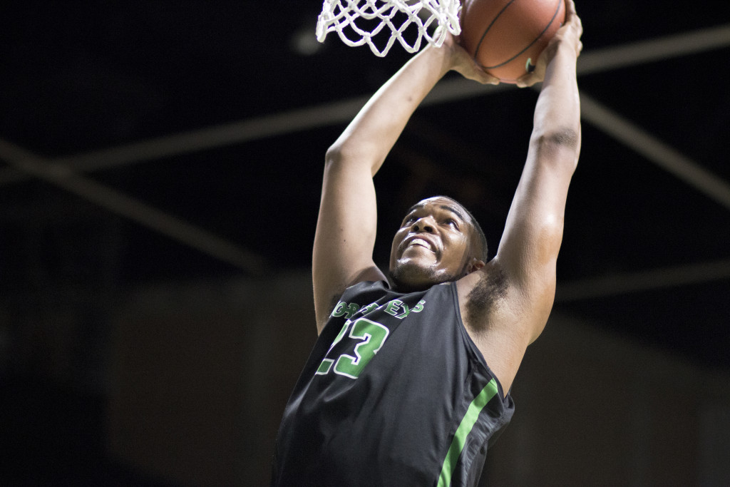 North Texas freshman center Rickey Brice (23) dunks against the Charlotte 49ers. Colin Mitchell | Senior Staff Photographer