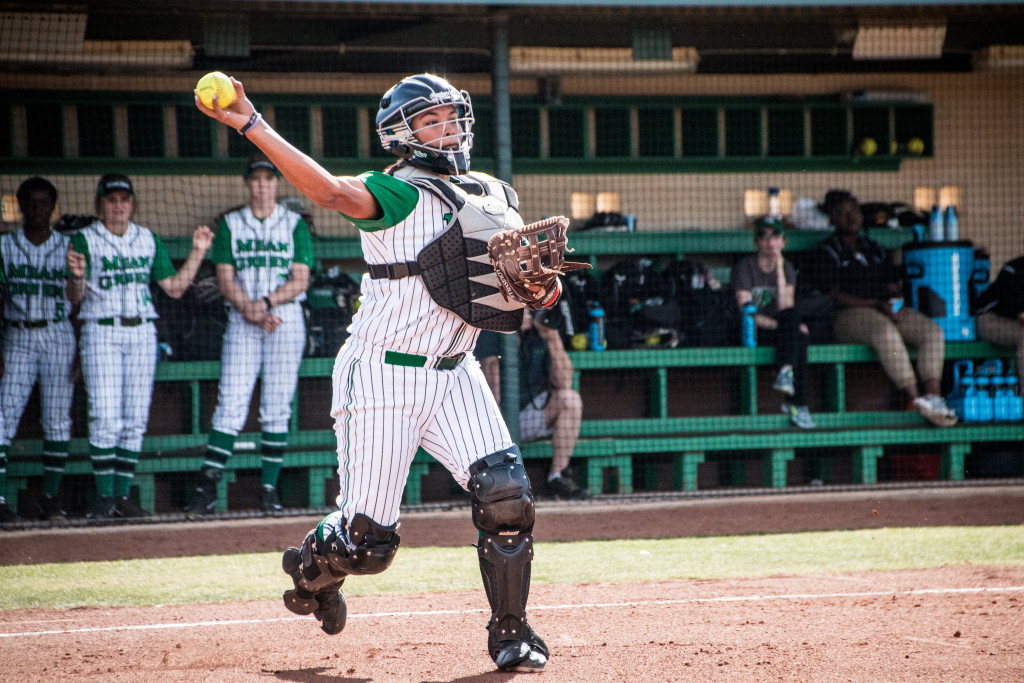 North Texas senior catcher Bryana Wade (23) throws a ball to first base to throw out a runner during the game against Nicholls State in the Mean Green Spring Fling Tournament. Dylan Nadwodny | Staff Photographer