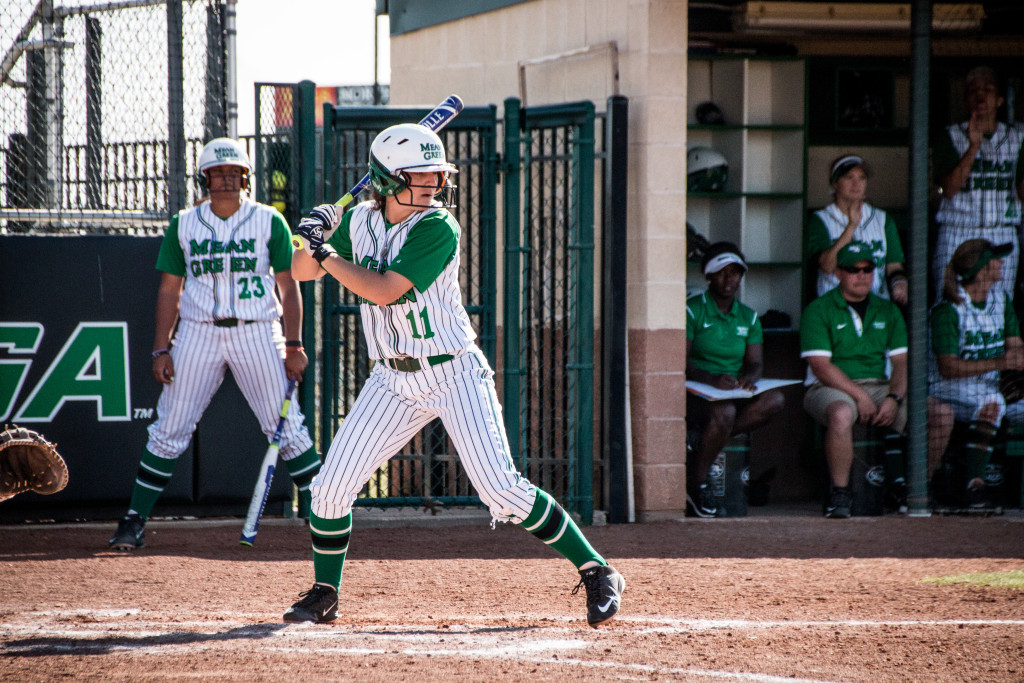 North Texas senior utility player Karly Williams (11) stands in the batters box as a pitch comes in during a game against Nicholls State in the Mean Green Spring Fling Tournament. Dylan Nadwodny | Staff Photographer