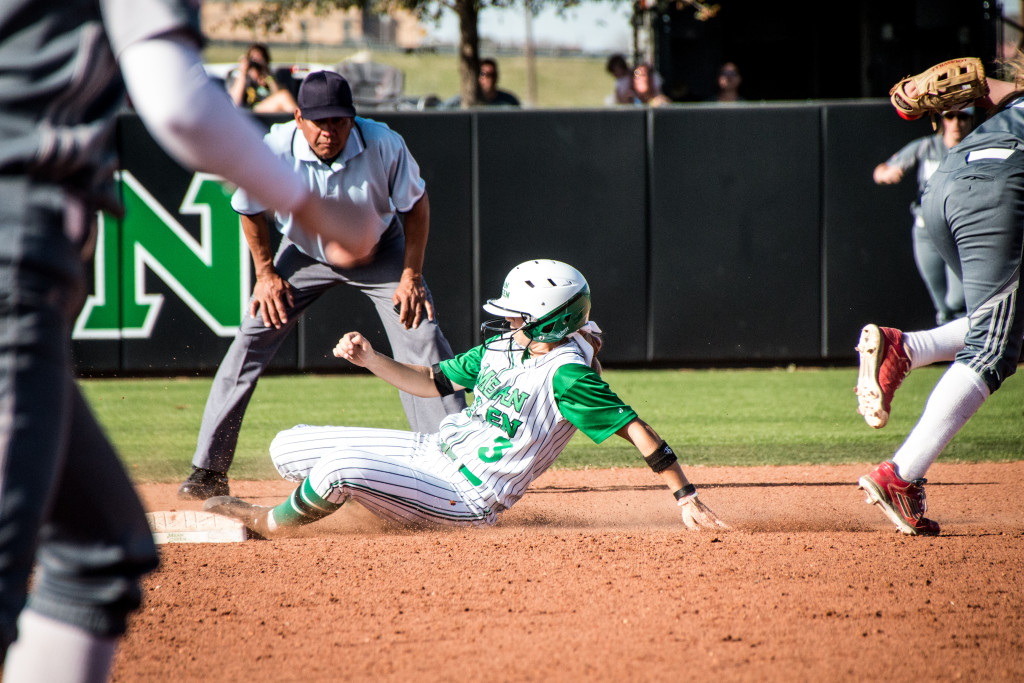 North Texas freshman utility player Harley Parella (3) slides into second base on a stolen base against Nicholls State during the Mean Green Spring Fling Tournament. Dylan Nadwodny | Staff Photographer