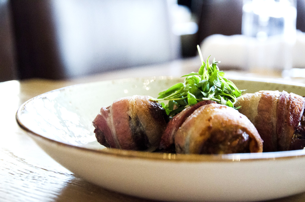Bacon Wrapped Medjool Dates with chorizo and piquillo sauce, a popular item on Barley and Boards small plate menu.
