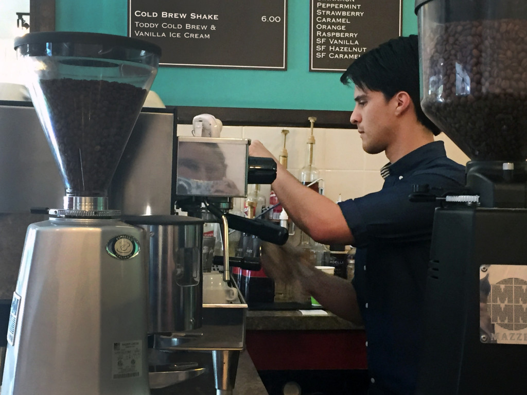 Big Mikes barista Aaron Aguilar makes a cup of joe during a shift.