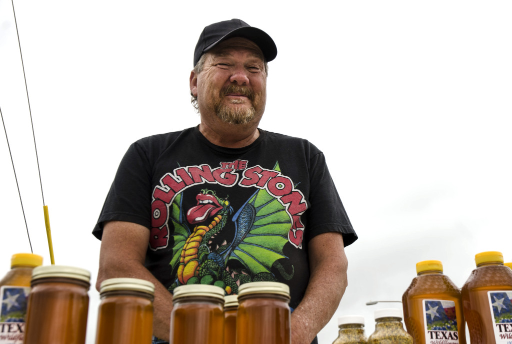 Robert Newton harvests his own honey from more than thirty hives on his Denton farm. He sets up his Wildflower Honey table on the corner of University Dr. and Carroll Blvd. Hannah Ridings | Senior Staff Photographer