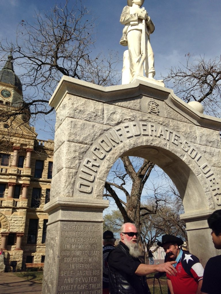 Members of the Denton Sons of Confederate Soldiers gather around the memorial on the Square.