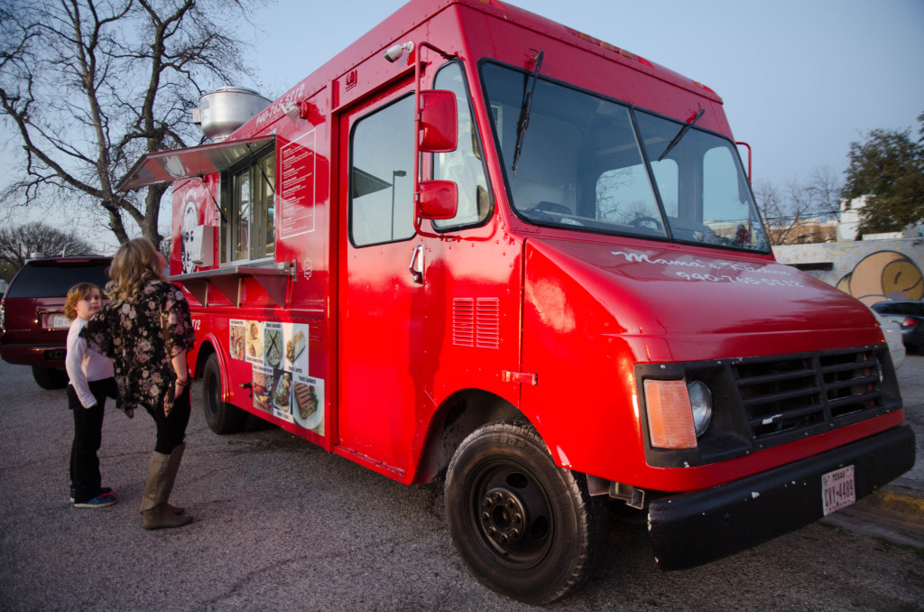 The bright red food truck is parked across the street from UNT campus, bringing home cooking to students. Hannah Ridings | Senior Staff Photographer