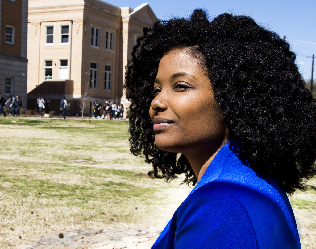 Communication Design Professor and Research Analyist, Terressa Hardaway smiles on a sunny day outside of UNT art building, Friday, Feb. 26, 2015. Staff Photographer| Kaylen Howard.