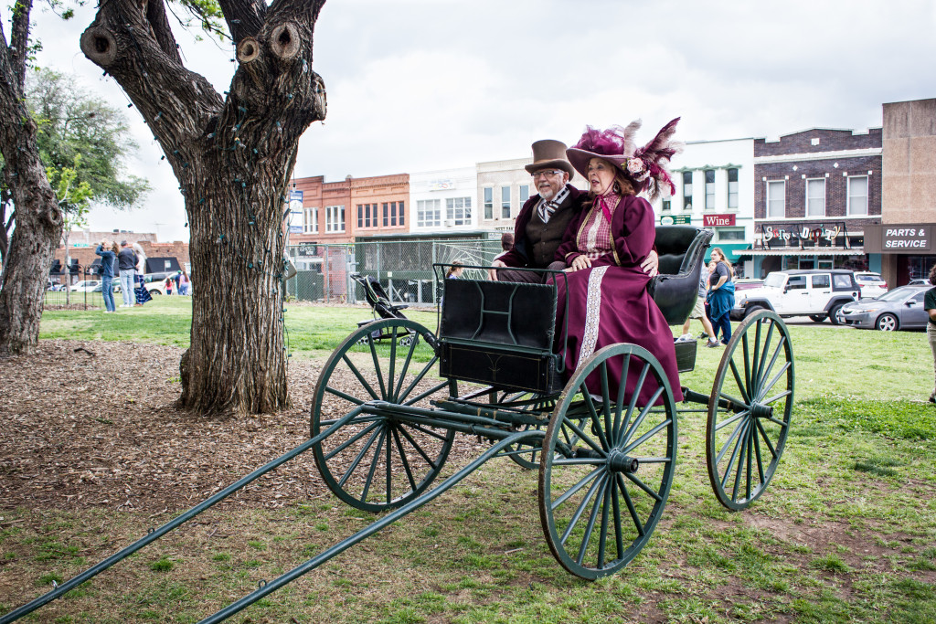 Historical Commission volunteers Paul and Georgiana McCoig ride a carriage at the 170th Denton County Anniversary on Saturday April 6, 2016 at the Denton Courthouse lawn. Paulina De Alva | Staff Photographer