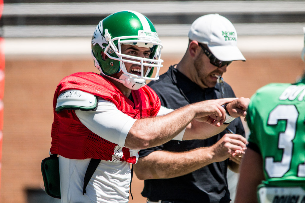 Redshirt junior quarterback Quinn Shanbour (19) barks out orders at the line of scrimmage in the North Texas Spring Football  Game. Dylan Nadwodny   Staff Photographer