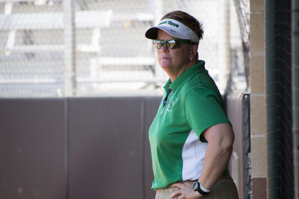 North Texas softball head coach Tracey Kee looks on during a game against Louisiana Tech. Dylan Nadwodny | Staff Photographer