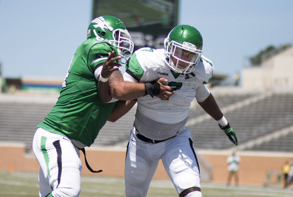 Sophomore defensive end Jareid Combs (7) tries to get around the offensive line for a sack against the green team during the spring game. Colin Mitchell   Senior Staff Photographer
