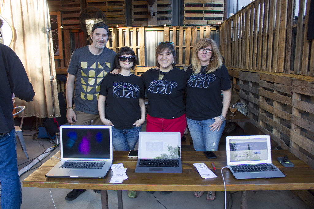 Board members of new incoming radio station KUZU 92.9 FM pose for a photograph in front of the donation laptops at the KUZUthon event at Harvest House on Friday April 22,  2016. Paulina De Alva | Staff Photographer