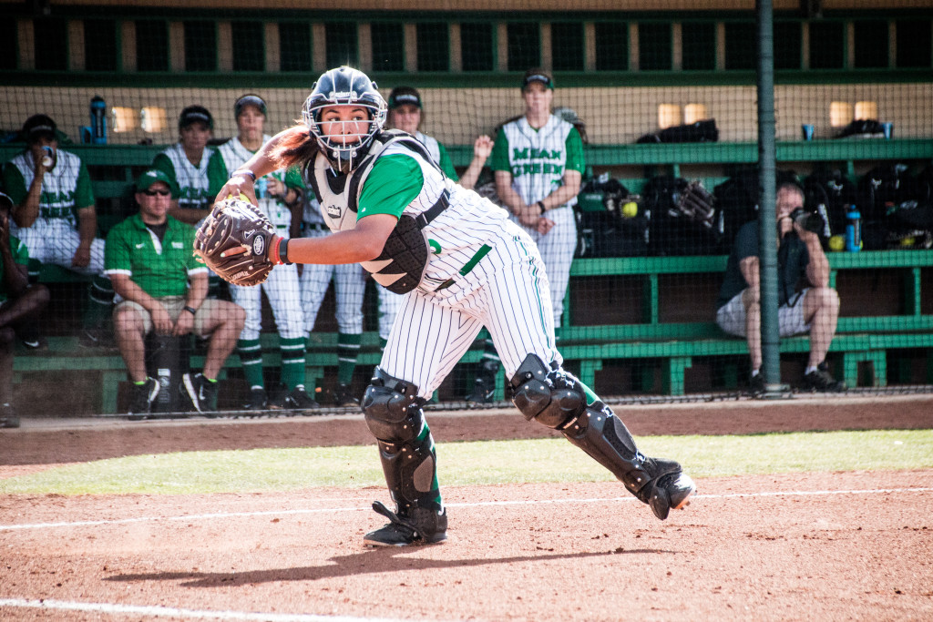 North Texas senior catcher Bryana Wade (23) fields a ball right in front of home plate and gets ready to throw it to first base against Nicholls State. Dylan Nadwodny | Staff Photographer