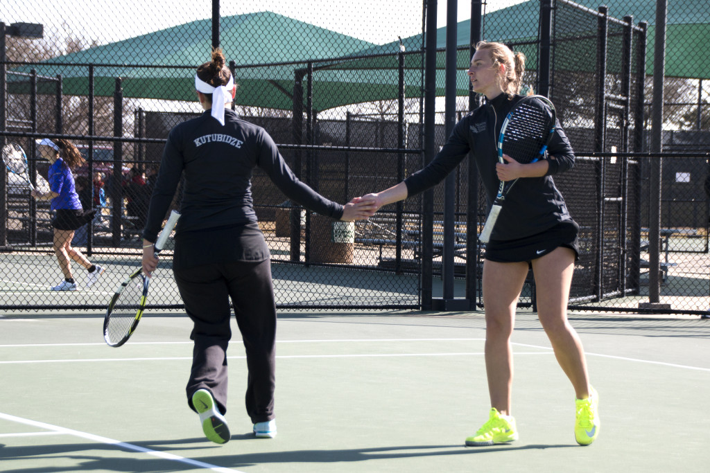 Freshmen Tamuna Kutubidze (left) and Maria Kononova (right) congratulate each other after a point in their doubles match against Central Arkansas. Dylan Nadwodny   Staff Photographer