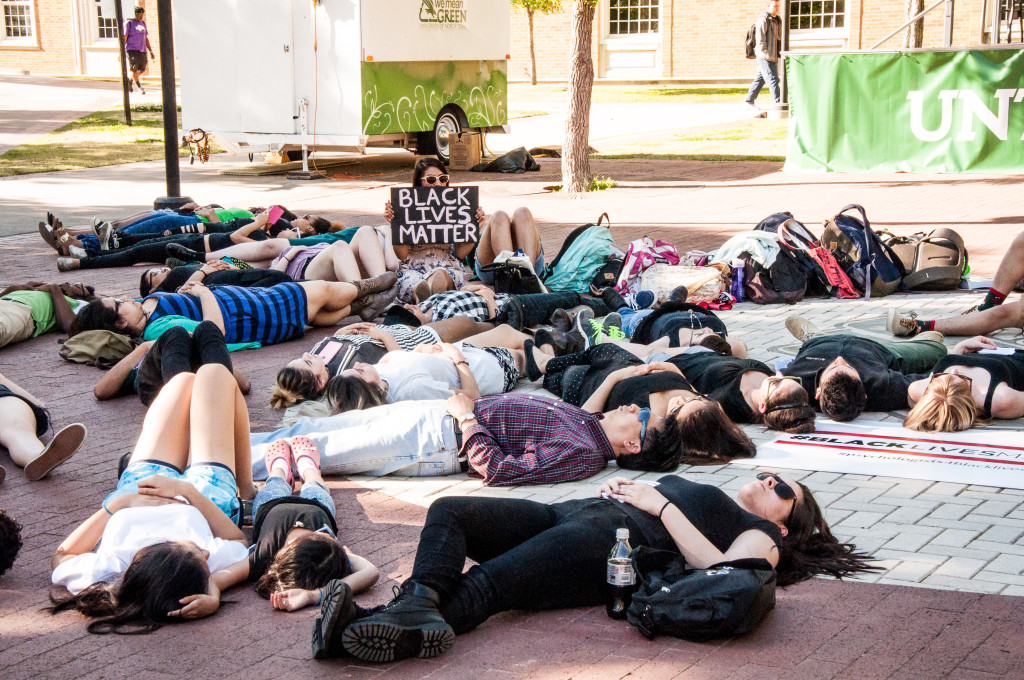 """Participants lay on the ground during the """"Die-In"""" demonstration for 16 minutes to represent the 16 bullets in Laquan McDonald and to raise awareness and conversation about the public mental health crisis resulting from police brutality. Sarah Bradbury 