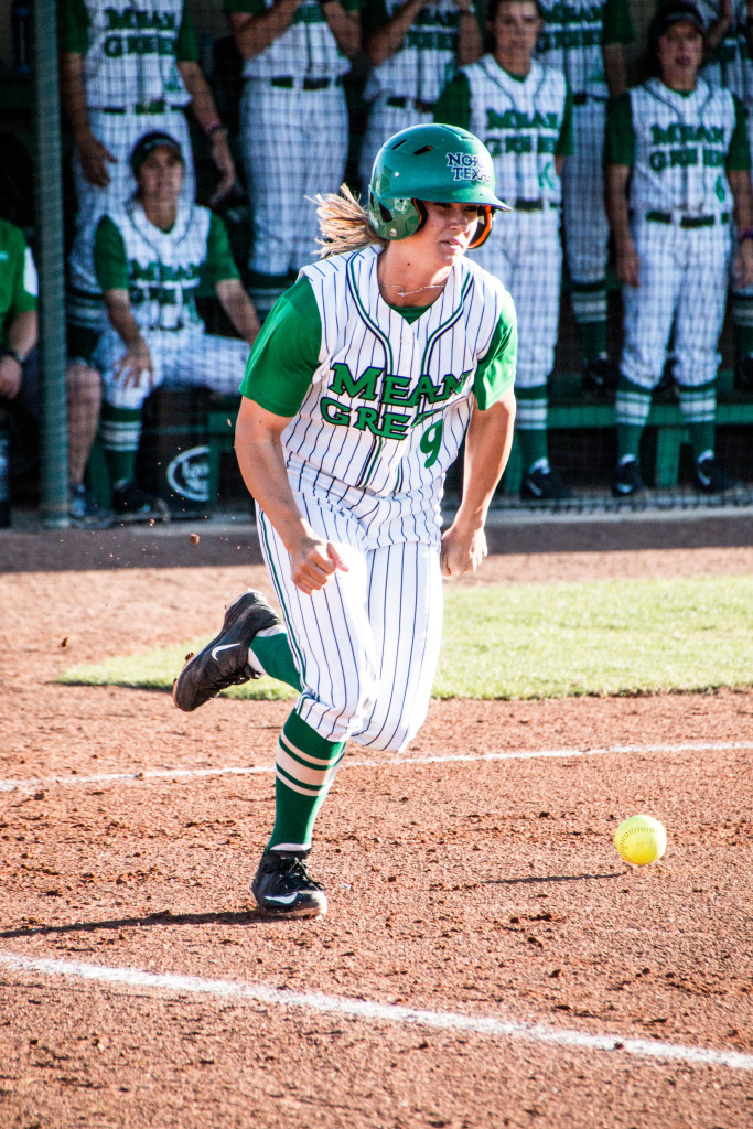 North Texas junior infielder Kelli Schkade (9) runs to first base after hitting a ball into the shallow part of the infield against the University of Texas at Arlington. Dylan Nadwodny | Staff Photographer