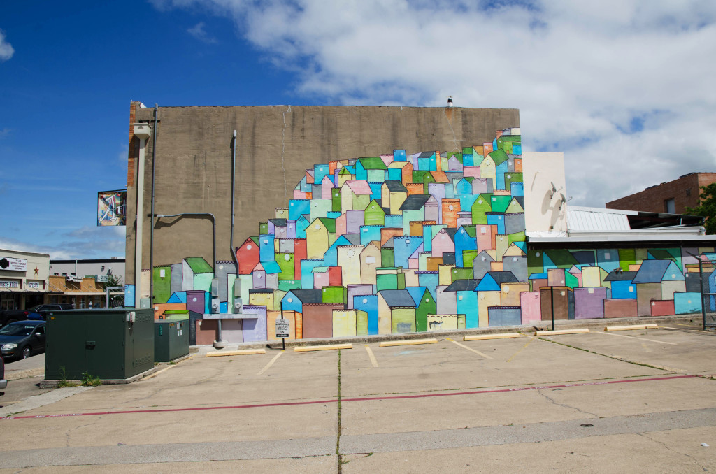 Mick Burson's murals can be seen all over the city of Denton. The houses mural can be seen on Oak street on the Downtown Square. Hannah Ridings | Senior Staff Photographer