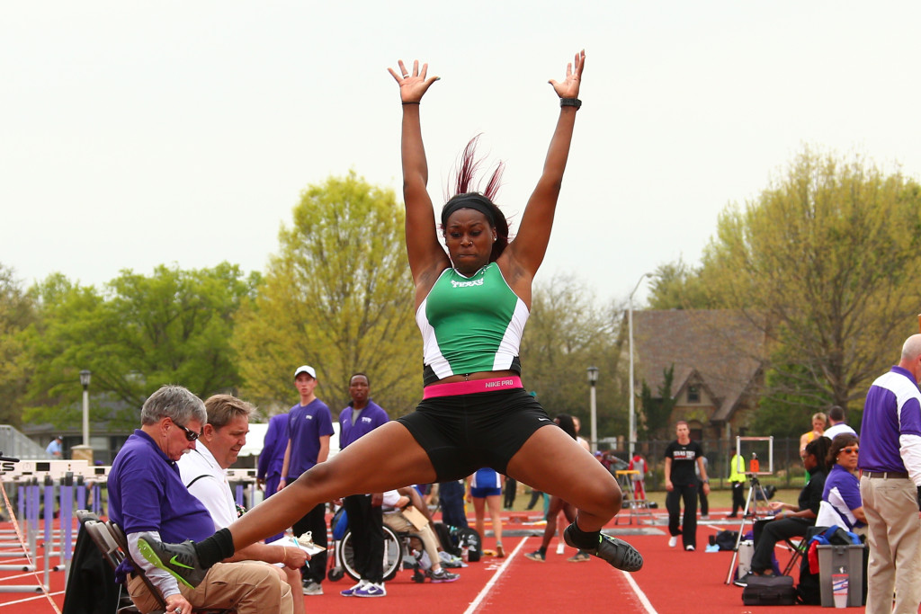 Senior sprinter and jumper Mona Landry extends after jumping off of the runway in the long jump at the TCU Invitational in Fort Worth. Courtesy | North Texas Athletics