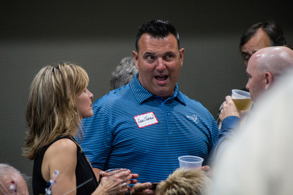 Incumbent Denton city council member Greg Johnson talks with supporters at a results watching party at the Best Western Premier on Brinker Road in Denton. Dylan Nadwodny | Staff Photographer