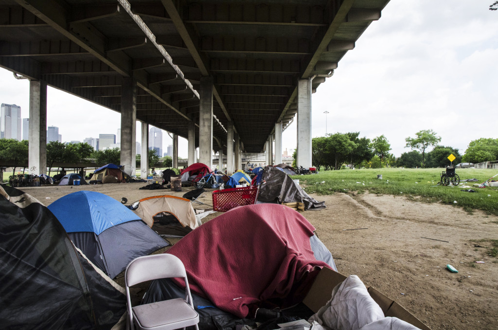 Tents are lined up under the Dallas bridge, the community known as Tent City must vacate the area by May 4, 2016. Hannah Ridings | Senior Staff Photographer
