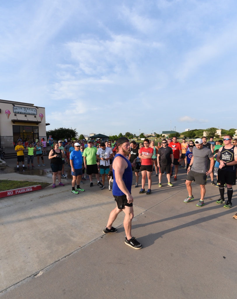 Bridgeman pumps up the Denton Area Running Club before going on about a three mile run.