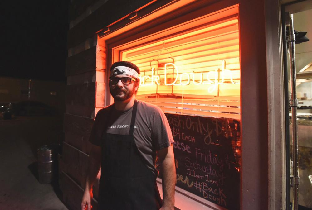 Tony Neglia, Chef de cuisine of Queenies, helps run the Back Dough team in the many orders placed by customers. Neglia and the team cook things like Strawberry Shortcake, Irish Coffee and Jalapeno Popper doughnuts.