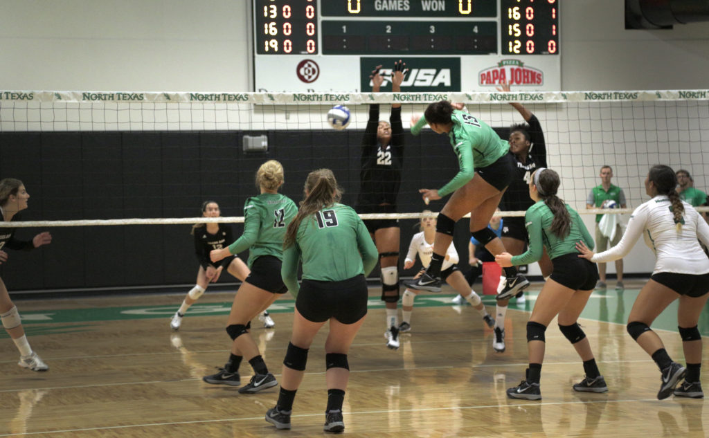 Mean Green volleyball junior Amanda Chamberlain spikes a ball into the opponents playing field Saturday in the North Texas Challenge. Tomas Gonzalez | Visuals Editor
