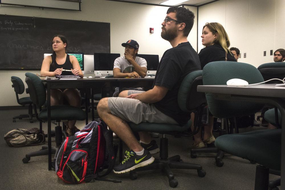A group of students listen intently during class in the General Academic Building. Tomas Gonzalez | Visuals Editor