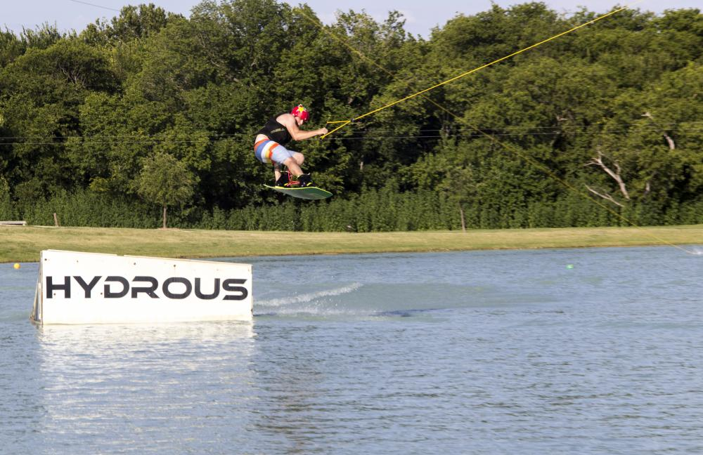 Aric Enciso makes a jump at Hydrous Wake Park in Little Elm. Hydrous also has a wakeboard park in Allen. Tomas Gonzalez | Visuals Editor