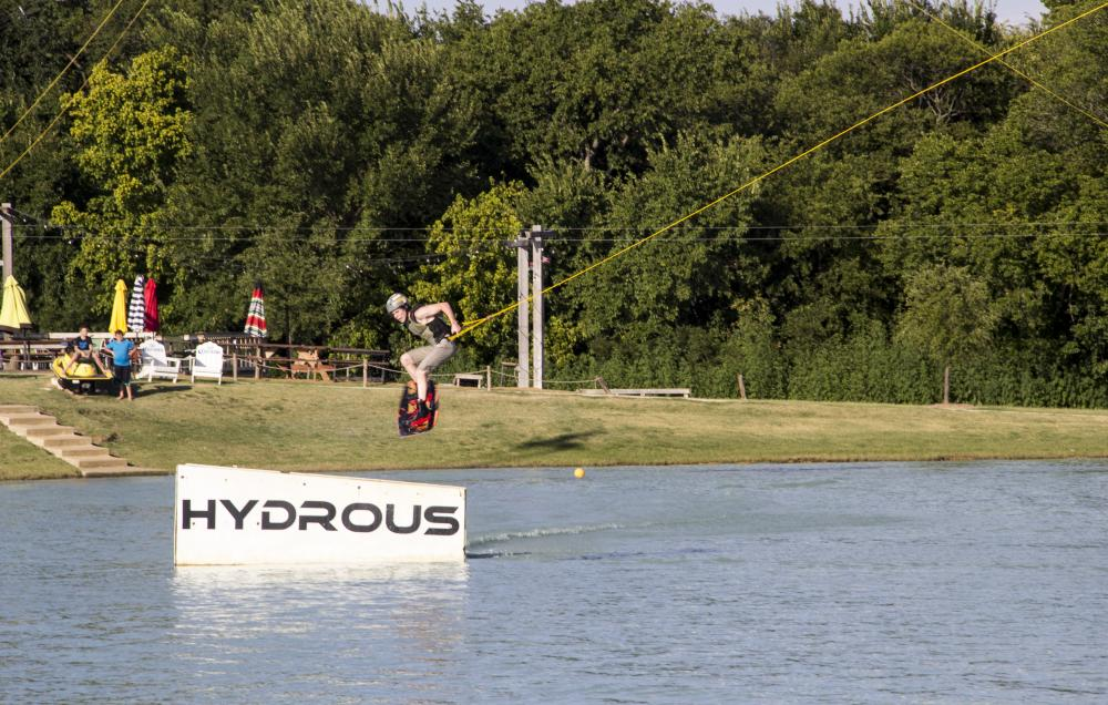 Brandon Warford, 17-year-old, makes a jump at Hydrous Wake Park in Little Elm. Tomas Gonzalez | Visuals Editor