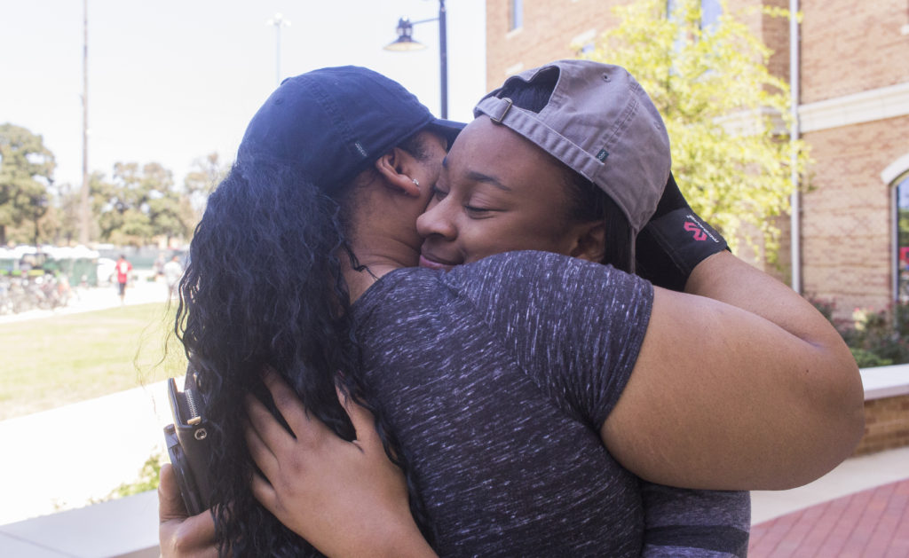 Business freshman Kiana Charles and her mother embrace before the families departure on Sunday afternoon for UNT move-in day. Tomas Gonzalez | Visuals Editor