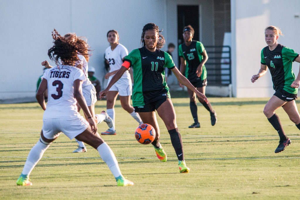 North Texas senior midfielder Marchelle Davis (11) recieves a pass and works the ball up the pitch against a Texas Southern defender on September 9. Dylan Nadwodny