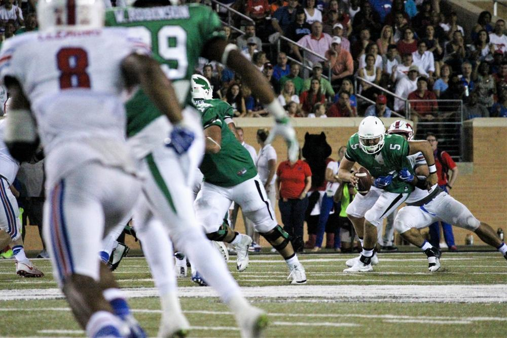 In the 4th quarter, UNT offense struggles to keep the Mustangs at bay, opening Senior Quarterback Alec Morris up for a tackle. Katie Jenkins