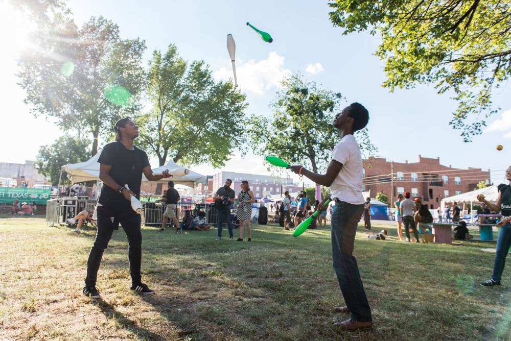 Timothy Walker and friend juggle on Friday at Oaktopia in front of the UNT stage. People gathered in front of the stage in preparation of Wavves to perform. Hannah Breland