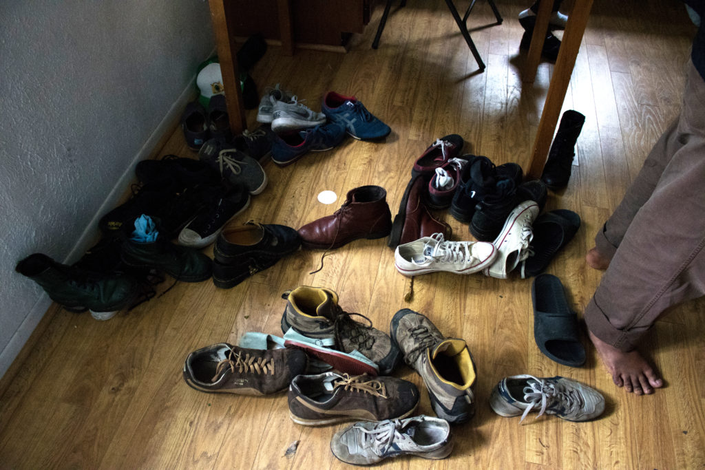The venue, a home in Denton, asked showgoers to remove their shoes for a Broketopia show. Broketopia was an alternative to Oaktopia Fest 2016 for people who wanted a more local taste of artists. Sara Carpenter