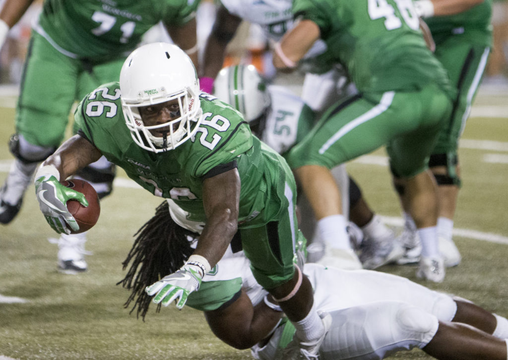 North Texas junior running back Jeffery Wilson dives on the sideline against Marshall. Colin Mitchell