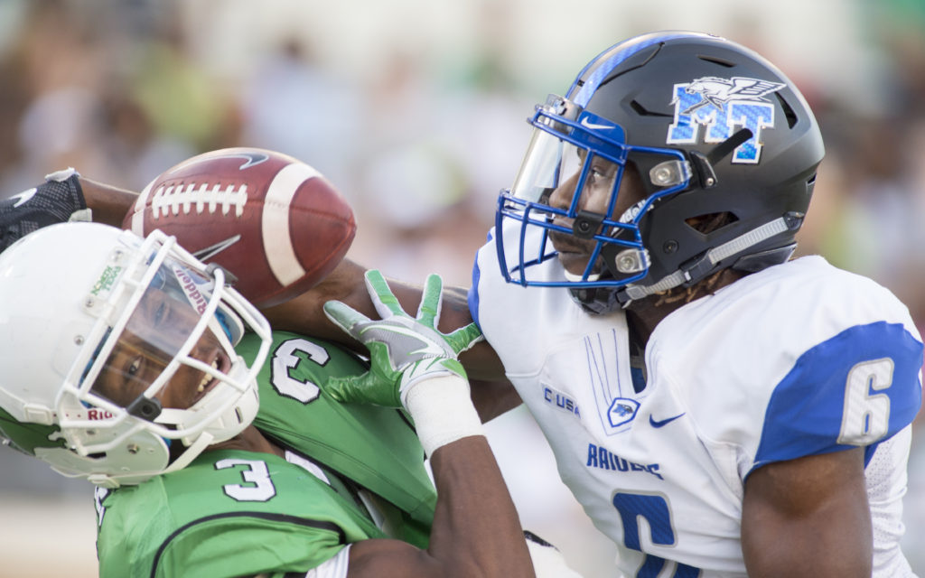 Sophomore wide reciever Tee Goree (3) attempts to catch a pass while being covered by MTSU corner back Michael Minter (6). North Texas scored during their first drive of the game. Colin Mitchell