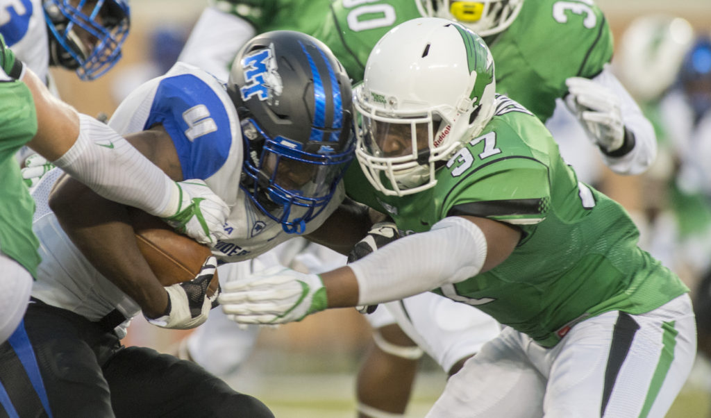 North Texas sophomore linebacker Brandon Gamer (37) tackles MTSU senior running back I'Tavius Mathers (4). Mathers ran for 140 yards on 24 carries. Colin Mitchell