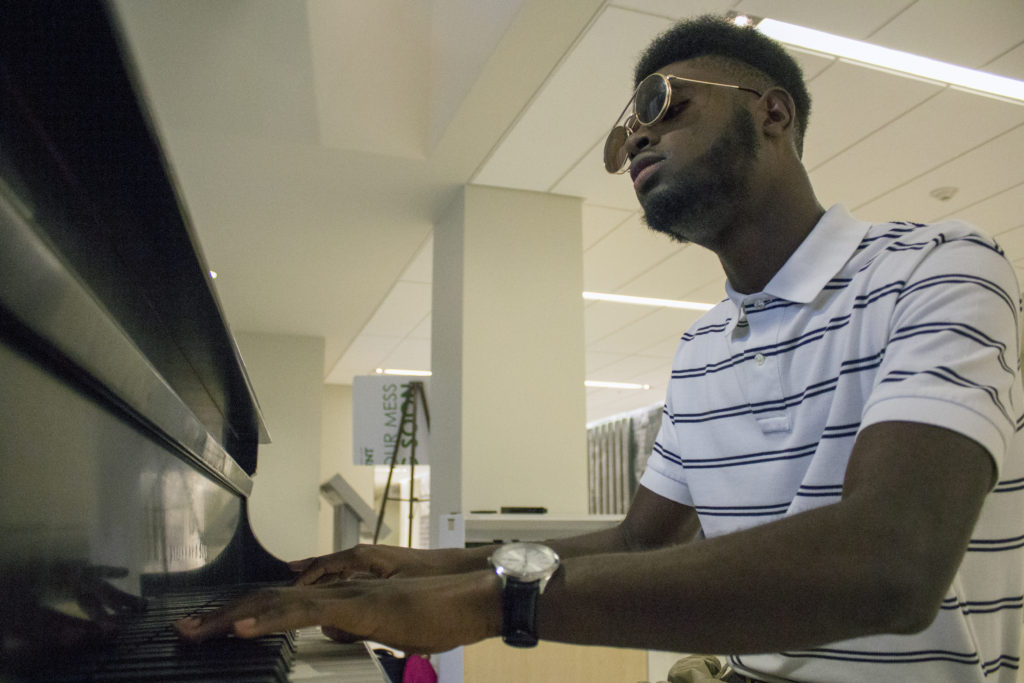 25/09/2016 Denton, Texas Norman Johnson plays the piano at the Union. Johnson is a sophomore kinesiology major and part of the track team at UNT. He started playing the piano 5 months ago after a foot injury limited his movement. For the past 2 months he has been producing music for a great number of artists. Jennyfer Rodriguez