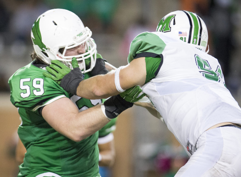 North Texas senior right guard Trey Keenan (59) blocks a Marshall lineman. Prior to playing at UNT, Keenan played for Texas Tech. Colin Mitchell