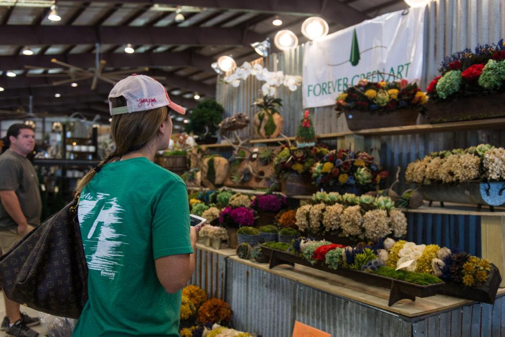Rachel Corbin, 39, of Sanger shops around the Forever Green Art vendor booth at the Vintage Market Days Event. Hannah Breland