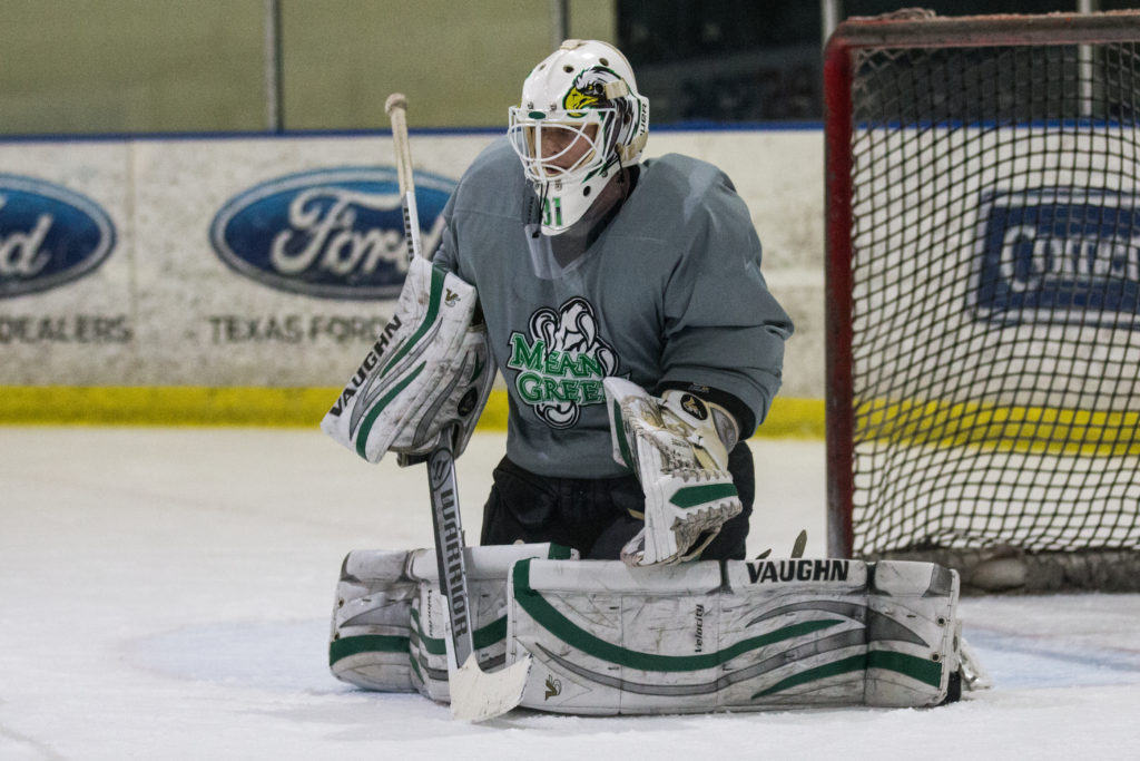 North Texas hockey goalie Bill Johndrow sets up in the butterfly position to save a shot during a practice at the Irving Dr Pepper StarCenter. Dylan Nadwodny