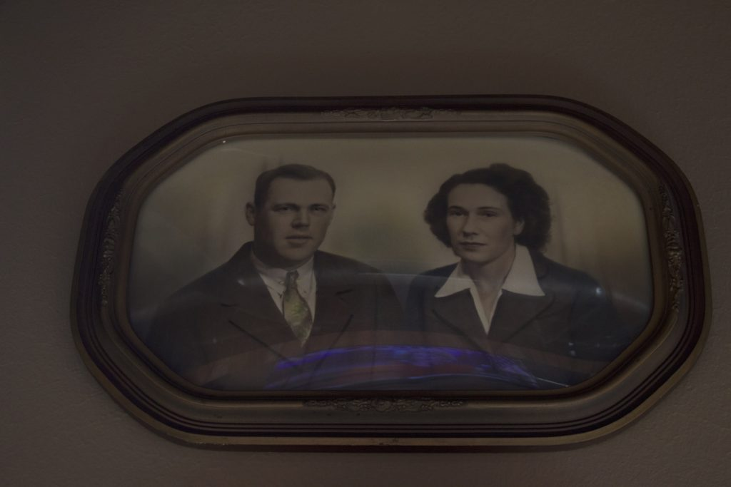 """In front of the bar, close to the ceiling, a photograph of Hooten's great-grandparents is perched on the wall. They are the """"Caskeys"""" whom the bar is named after. Kyle Martin"""
