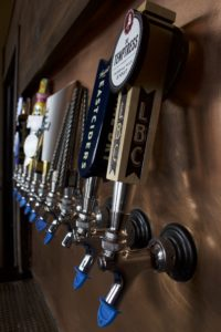 Extra copper sheeting from the bar top was used as the backdrop for the draft taps behind the bar. Kyle Martin