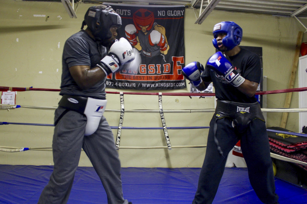 Flint Boxer Corey Richards, 32, dodges a jab from his sparing partner and trainee Brian Flowers, 22. Austin Jackson