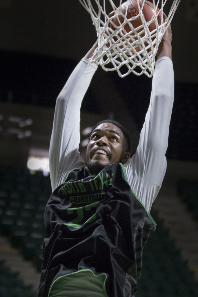 North Texas sophomore center Rickey Brice dunks during practice. Colin Mitchell