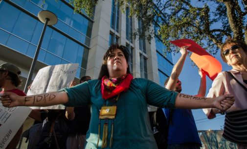 Crowd protests pipeline 1,200 miles away outside energy firm's Dallas HQ