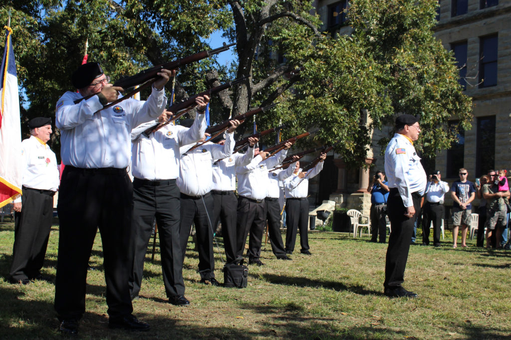 Members of the Vietnams Veterans of America perform a rifle volley to honor fellow veterans during a Veteran's Day Service in Denton Square. Ian Melo